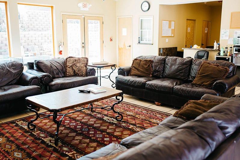 Claudia Black Center men's living room